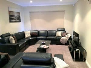 tv room with coffee table accommodation