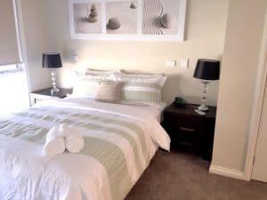 clean carpet floored bedroom
