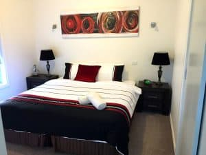 big bedroom with side tables and lamps