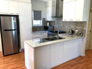 modern kitchen with wooden floors