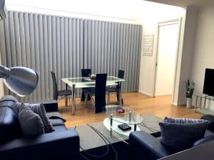 large lounge room with glass coffee table